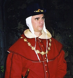 Red Wool Hood with liripipe, lined in Gold brocade with wooden buttons