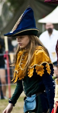 Gold Oakleaf Dagged Velvet Hood and Liripipe, lined in Regal Blue Velvet and trimmed Gold and Green Braid and Pewter Jewelled buttons centre front (With Kind Permission from The Abbey Museum)