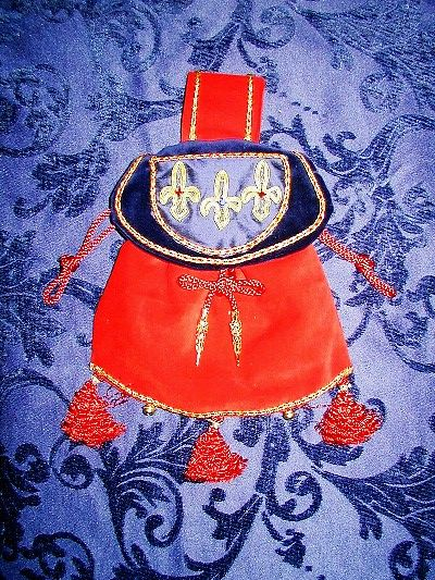 Red and blue velvet pouch with classic fleur-de-lys reproduced in goldwork