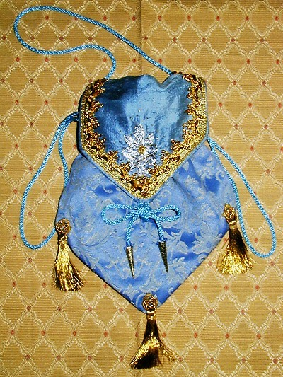 Pale blue brocade pouch with goldwork on silk