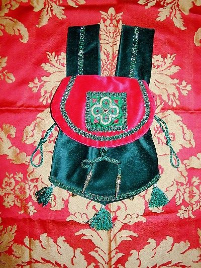 Red and green velvet pouch with quatrefoil goldwork and silkwork with jewels reproduced from a brooch on the throat of figure in a Fresco in Westminster Palace