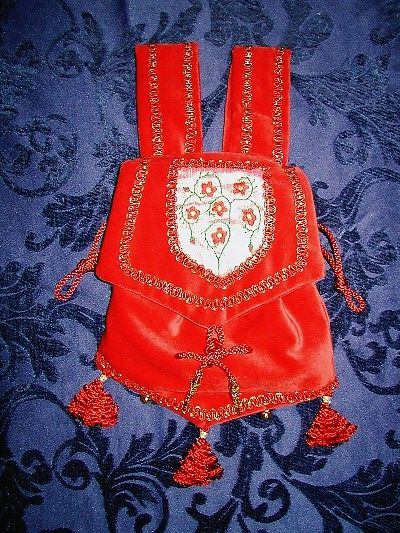 Red velvet pouch with goldwork and silkwork reproduced from the Manesse Codex